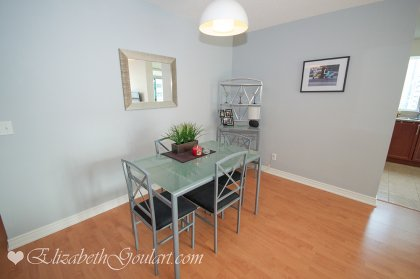 Dining Area With Laminate Flooring Throughout.