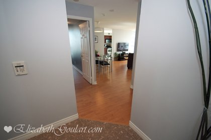 Suite Foyer With Granite Flooring & Mirrored Closets.