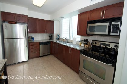 Designer Kitchen Cabinetry With Stainless Steel Appliances, Granite Counter Tops, An Eat In Kitchen & Walk-Out Balcony.