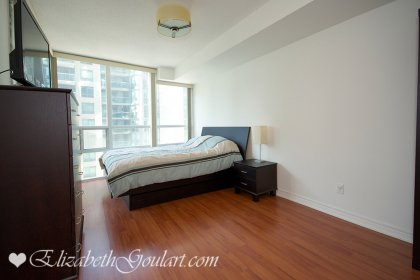 Spacious Sized Master Bedroom With A Large Closet & A Walk-Out Balcony.