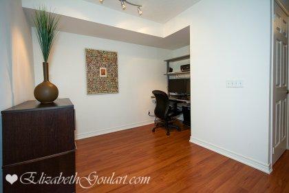 Den Area With Laminate Flooring.