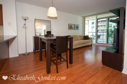 Dining Area With Laminate Flooring.