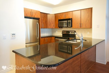 Designer Kitchen Cabinetry With Upgraded Stainless Steel Appliances, Extra Thick Granite Counter Tops, Undermount Sink & A Breakfast Bar.