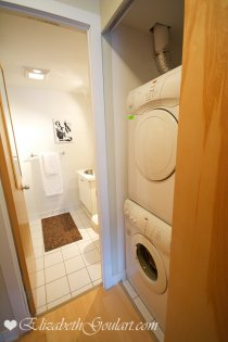 Conveniently Located Master Bedroom Laundry Area With Stacked Front Loading Washer & Dryer.
