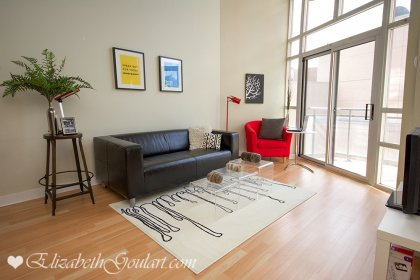 Living & Dining Areas With New Laminate Flooring & Soaring 16' Floor-To-Ceiling Windows.