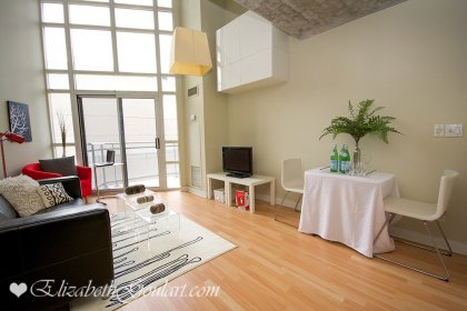 Dining & Living Areas With New Laminate Flooring & Soaring 16' Floor-To-Ceiling Windows.