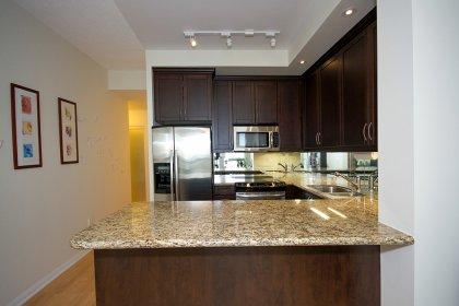 Gorgeous Designer Kitchen Cabinetry With Stainless Steel Appliances, Granite Flooring & Counter Tops, Undermount Sink, Mirrored Backsplash & Valance L