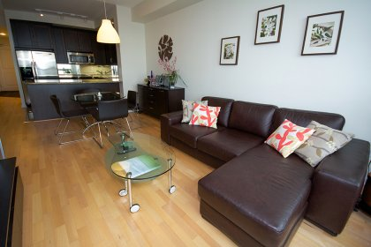 Living & Dining Areas With Gleaming Hardwood Flooring Throughout Facing Stunning Unobstructed Lake Views.