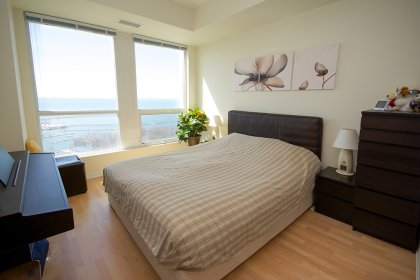 Spacious Sized Master Bedroom With A 3-Piece Ensuite, Walk-In Closet, Gleaming Hardwood Flooring Throughout Facing Stunning Unobstructed Lake Views.