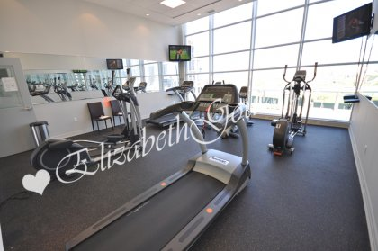 11th Floor Harbour Club Amenities. Cardio Room Overlooking Park Views.
