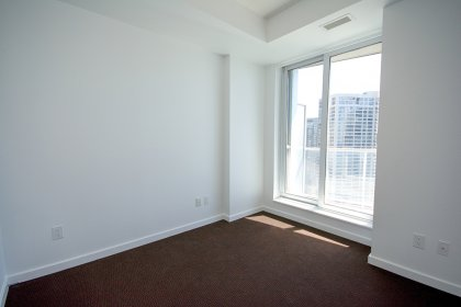 Spacious Sized Bedroom With A Walk-In Closet & Walk-Out Balcony Facing Stunning Unobstructed Lake Views.