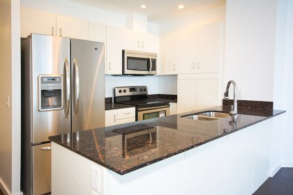 Designer Kitchen Cabinetry With New Stainless Steel Appliances, Granite Counter Tops, Undermount Sink & Pot Lighting.
