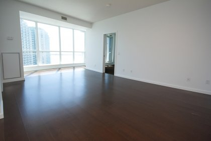Bright 9� Floor-To-Ceiling Windows With Gleaming Hardwood Flooring Facing Stunning Unobstructed Lake Views.