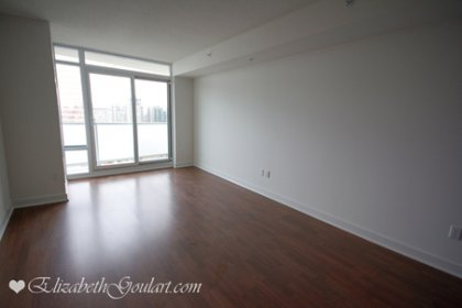 Living & Dining Areas With Bright Floor-To-Ceiling Windows & Laminate Flooring Facing Unobstructed South City Views.