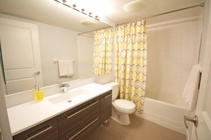 Main Bath With A 4-Piece, Full Mirror & Upgraded Vanity.