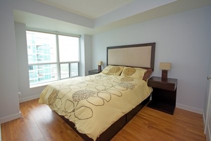 Spacious Sized Master Bedroom With A Walk-In Closet & Laminate Flooring Throughout.