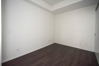 2nd Bedroom With Double Closets & Hardwood Flooring Throughout.