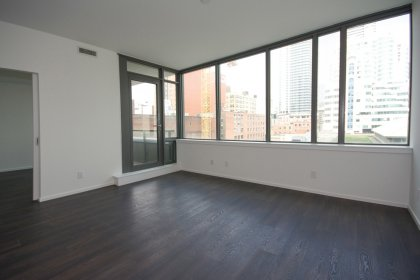 Spacious Sized Living Areas With A Separate Den & Hardwood Flooring Throughout.