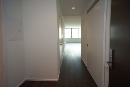 Suite Foyer Entrance With Hardwood Flooring Throughout.