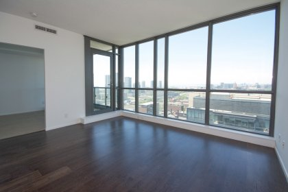 Bright Floor-To-Ceiling Windows With Hardwood Flooring Throughout The Living /Dining Areas Facing Stunning Unobstructed West Views.