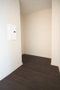 Den Area With Hardwood Flooring Throughout.