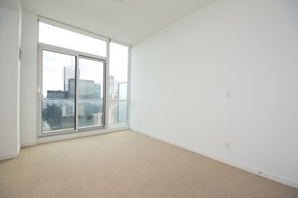Spaciuos Sized Bedroom With A 4-Piece Ensuite, Closet & Walk-Out Balcony Facing Stunning C.N. Tower & City Views.