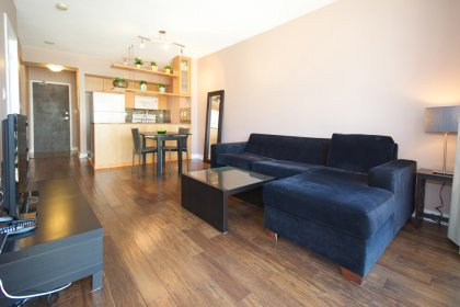 Bright Floor-To-Ceiling Windows With New Hardwood Flooring Throughout.