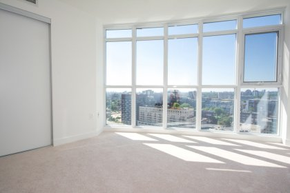 Spacious Sized Master Bedroom With A Large Closet & Unobstructed City Views.