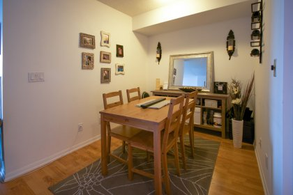 Open Concept Den Area With Hardwood Flooring.