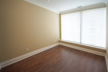 2nd Bedroom With Crown Moulding, Pot Lighting, Mirrored Closets & Hardwood Flooring.