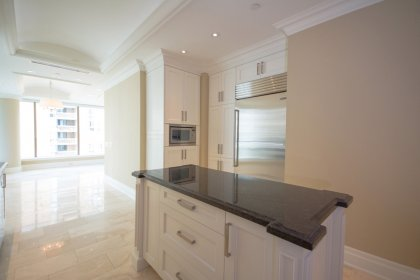 Designer Kitchen Cabinetry Fitted With The Latest In Cutting-Edge Designed Stainless Appliances, Granite Counter Tops, Undermount Sink & Valance Light