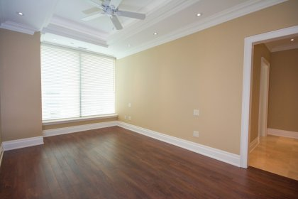 Bright High Ceilings With Hardwood Flooring, Coffered Ceiling, Crown Moulding & Pot Lighting.