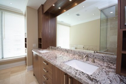 Gorgeous Master Ensuite With Crown Moulding, Pot Lighting, Full Sized Mirror With Custom Vanity Organizers, Marble Counter Tops & Undermount Sinks.