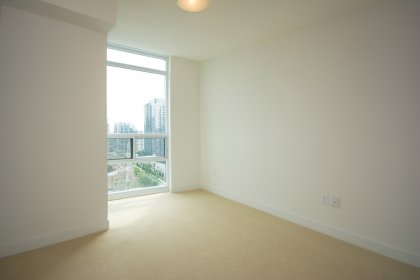 Spacious Sized 2nd Bedroom With A Large Window & Mirrored Closet.