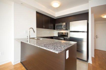 Designer Kitchen Cabinetry With Stainless Steel Appliances, Granite Counter Tops, Undermount Sink, Undermount Lighting, Backsplash & A Breakfast Bar.