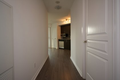 Front Foyer With Plank Laminate Flooring Throughout.