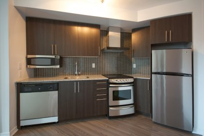 Designer Kitchen Cabinetry With Stainless Steel Appliances, Granite Counter Tops & Undermount Sink.