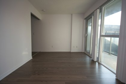 Open Concept Living/Dining Areas With Bright Floor-To-Ceiling Windows & Plank Laminate Flooring Throughout.