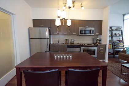 Designer Kitchen Cabinetry With Stainless Steel Appliances, Granite Counter Tops, Undermount Sink & Hardwood Flooring.