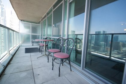 A Huge Private Balcony Facing Stunning Unobstructed C.N. Tower & Lake Views.