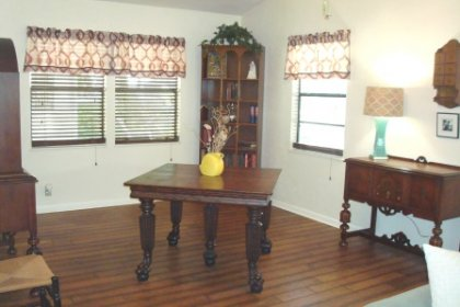 The current homeowner uses this space as a dining room. It could also be a cozy space for sewing, scrapbooking, music, or reading.