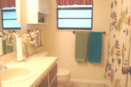 Bathroom #2 has a tub and shower combo, ceramic tile floors, and a large vanity.
