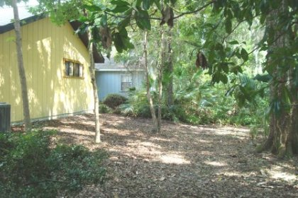 The lot is adjacent to a wooded area with a small creek. There is plenty of room to add a deck or back screen room.