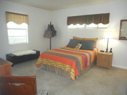 The master bedroom is large enough for a king size bed. There is a spacious walk-in closed and attached bath in the master bedroom.