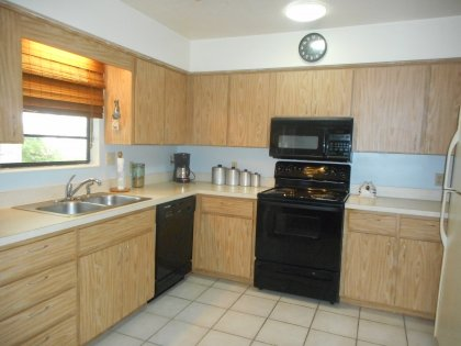 Spacious kitchen with new stove (Oct 2013), newer dishwasher (Jan 2013), new over the range microwave,tile floor, and tube skylight.