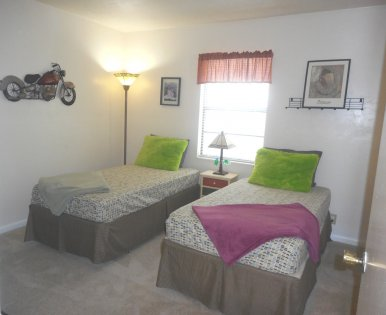 The second bedroom is spacious enough for twin beds. The bedroom is carpeted. The closets are reach-in.