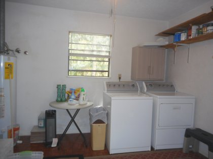 The laundry room is accessible from the master bathroom and from the carport. Washer and dryer are not included in the sale of the home.