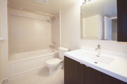 Main Bathroom With A 4-Piece & Semi Ensuite Into The Master Bedroom.