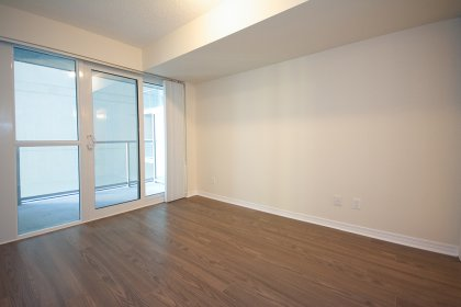 A Spacious Sized Master Bedroom With An Semi Ensuite, Walk-In Closet & Walk-Out Balcony.
