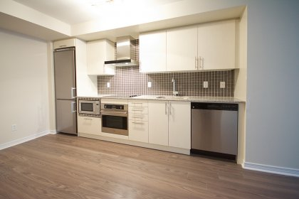 Upgraded Designer Kitchen Cabinetry With Stainless Steel Appliances, Granite Counter Tops & Undermount Sink.